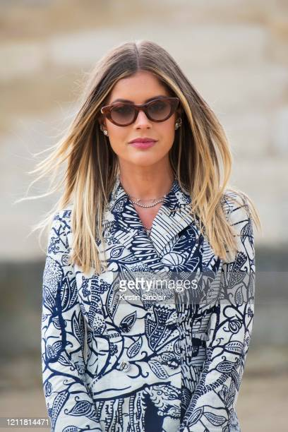 Digital influencer Lala Trussardi Rudge wears a Dior jacket and Moncler sunglasses on February 25 2020 in Paris France