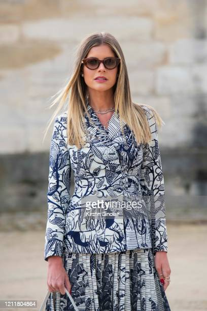 Digital influencer Lala Trussardi Rudge wears a Dior jacket and skirt and Moncler sunglasses on February 25 2020 in Paris France