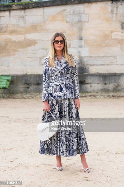 Digital influencer Lala Trussardi Rudge wears a Dior jacket skirt and saddle bag Amina Muaddi shoes and Moncler sunglasses on February 25 2020 in...