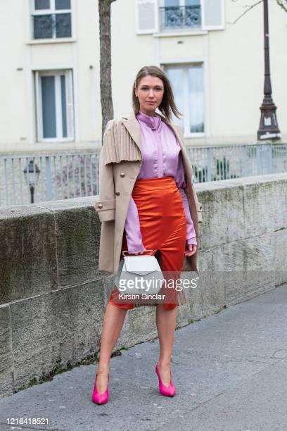 Digital influencer Landiana Yolo wears a Maestoso bag, Hardot shoes, Ramelle skirt, Diana Caramaci shirt and Chaotic trench coat on February 26, 2020...
