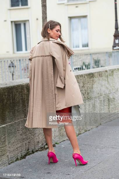 Digital influencer Landiana Yolo wears a Ramelle skirt and a Chaotic trench coat on February 26, 2020 in Paris, France.