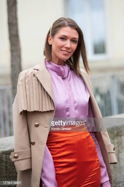 Digital influencer Landiana Yolo wears a Ramelle skirt, Diana Caramaci shirt and a Chaotic trench coat on February 26, 2020 in Paris, France.