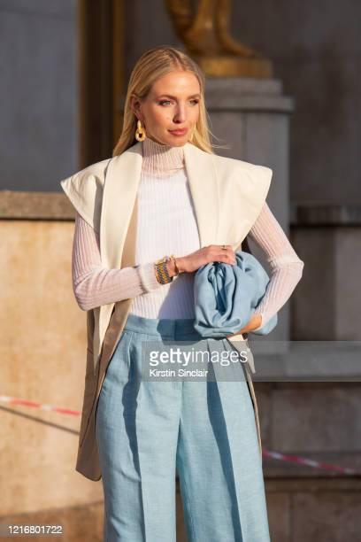 Digital influencer Leonie Hanne wears a Bottega Veneta bag and jewellery, Max Mara coat, Philip Lim trousers, Theory jumper on February 26, 2020 in...