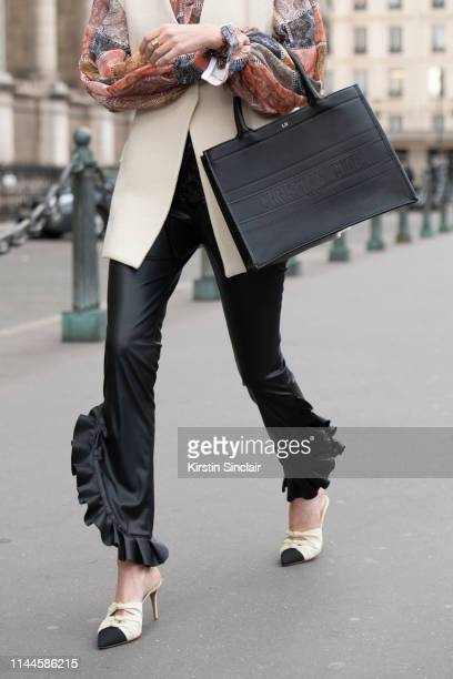 Digital Influencer Leonie Hanne wears a Zimmermann shirt Redemption trousers Dior bag and Aquazurra shoes on February 28 2019 in Paris France