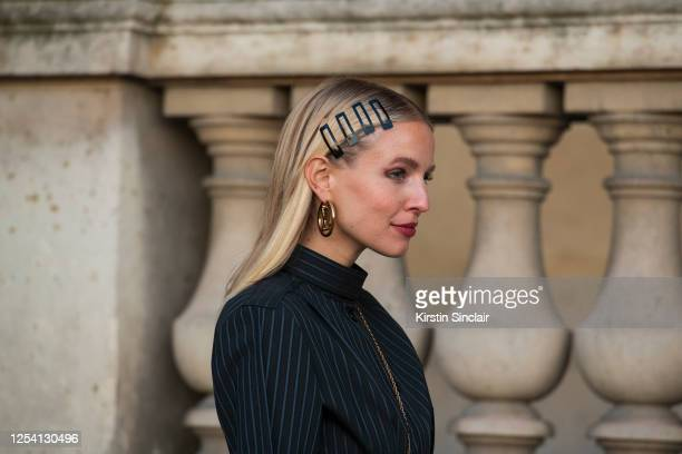 Digital influencer Leonie Hanne wears all Louis Vuitton with snap on hair clips on March 03, 2020 in Paris, France.