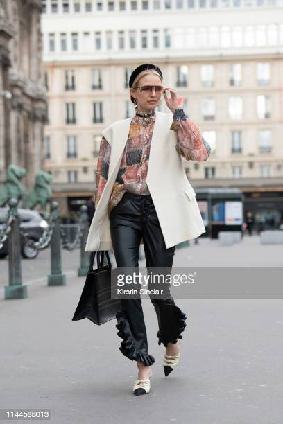 Digital Influencer Leonie Hanne wears Jennifer Behr headband a Zimmermann shirt Dior earrings Redemption trousers Dior bag and Aquazurra shoes on...