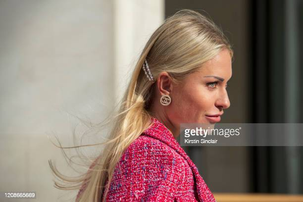 Digital influencer Lexi Fargo wears a Chanel jacket earrings and hair clip during London Fashion Week February 2020 on February 14 2020 in London...