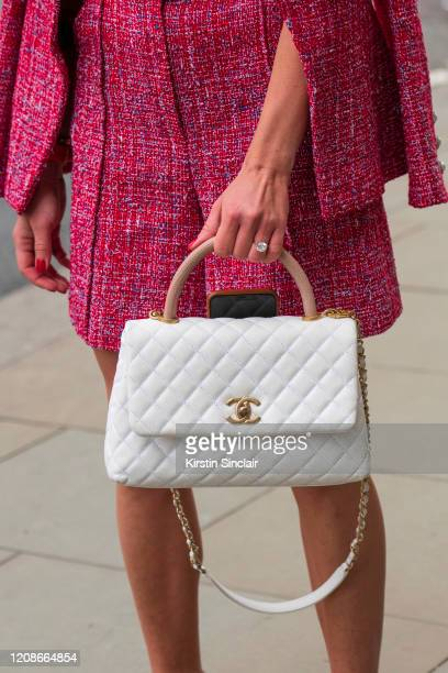 Digital influencer Lexi Fargo wears a Chanel jacket shorts and bag during London Fashion Week February 2020 on February 14 2020 in London England