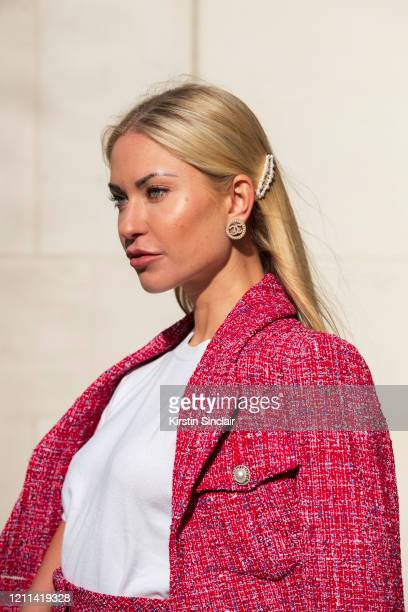 Digital influencer Lexi Fargo wears a Chanel top earrings jacket and hair accessories during London Fashion Week February 2020 on February 14 2020 in...