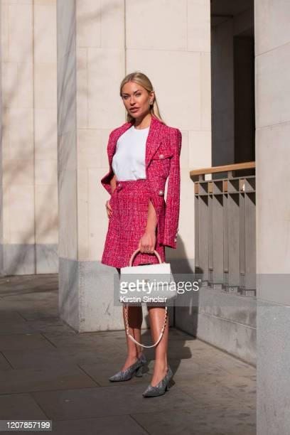 Digital influencer Lexi Fargo wears a Chanel top skirt earrings jacket bag and hair accessories with Bottega Veneta shoes during London Fashion Week...