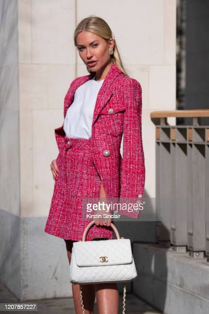 Digital influencer Lexi Fargo wears a Chanel top skirt earrings jacket bag and hair accessories during London Fashion Week February 2020 on February...