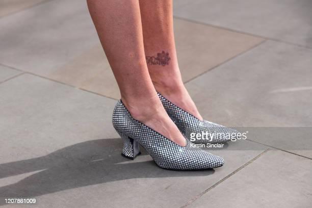Digital Influencer Lexi Fargo wears Bottega Veneta shoes during London Fashion Week February 2020 on February 14 2020 in London England