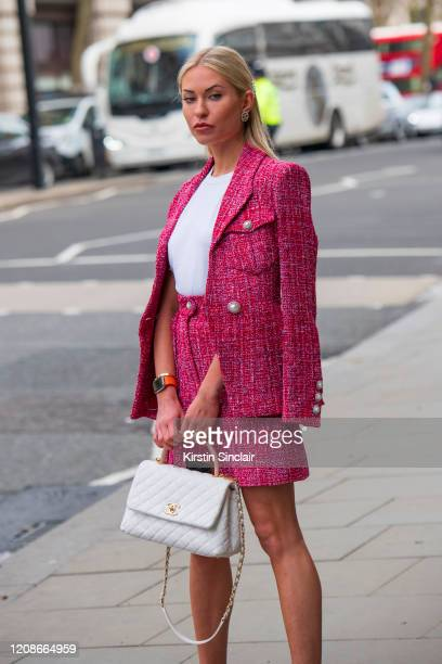 Digital influencer Lexi Fargo wears Chanel top shorts jacket bag and hair accessories during London Fashion Week February 2020 on February 14 2020 in...