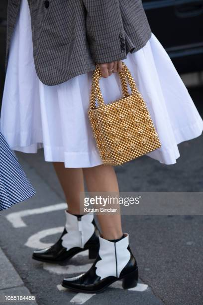 Digital Influencer Linda Tol wears a Frankie dress Alexa Chung jacket and boots and a Shrimps bag during London Fashion Week September 2018 on...