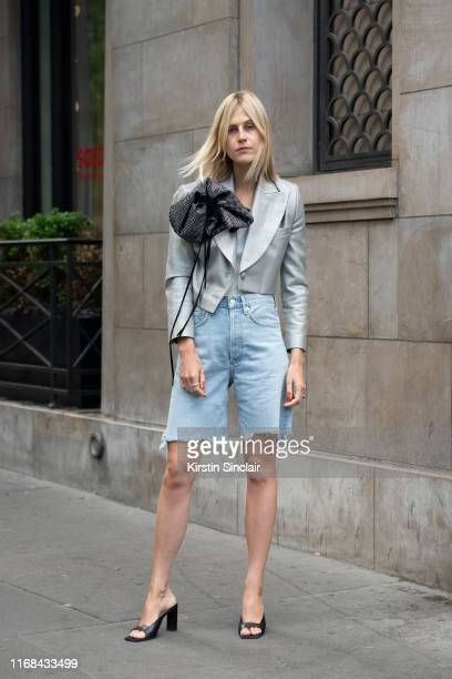 Digital influencer Linda Tol wears Wandler shoes Magda Butrym jacket and Agolde denim shorts on July 01 2019 in Paris France