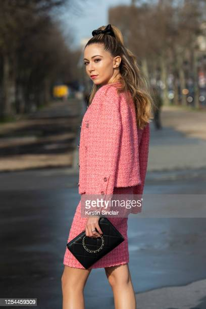 Digital influencer Lyna Zerrouki wears all Chanel with a black bow in her hair on March 03, 2020 in Paris, France.
