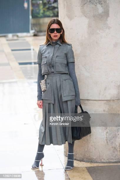 Digital influencer Mascarada wears a Balmain handbag, Paco Rabanne small bag, Maxmara top and skirt, Amina Muaddi shoes and Tom Ford sunglasses on...