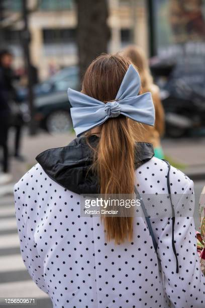 Digital influencer Mascarada wears a Balmain jacket and tops and a big light blue bow in her hair on March 03, 2020 in Paris, France.