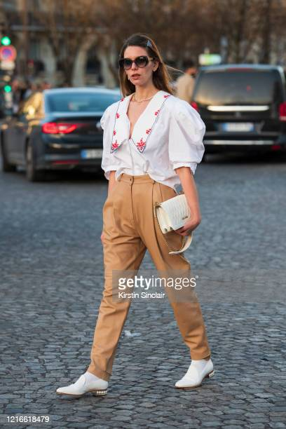 Digital influencer Mascarada wears all Miu Miu with Gucci sunglasses and Prada hair clips on February 26 2020 in Paris France