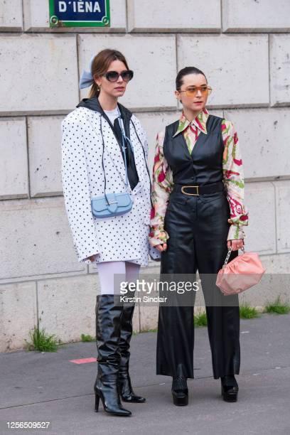 Digital influencer Mascarada wears Pucci sunglasses, Prada bag, Balmain jacket and tops and Giuseppe Zanotti boots with Digital influencer Julia...