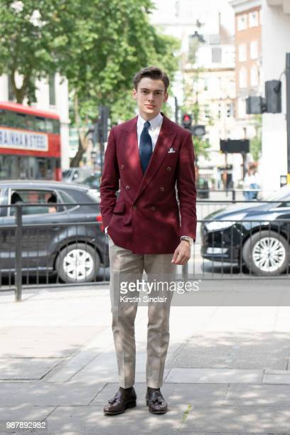 Digital Influencer Mathias le Feuvre wears an Alexandre Wood jacket trousers and tie Eaton shirt and Camina shoes during London Fashion Week Men's on...