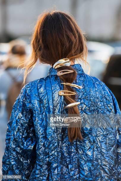 Digital influencer Ángela Rozas Saiz wears a Rochas top and hair clips in her hair on February 26, 2020 in Paris, France.