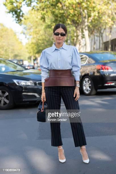 Digital influencer Paola Alberdi wears Christian Louboutin shoes Loewe shirt trousers bag and belt and Gucci sunglasses during Paris Fashion Week...