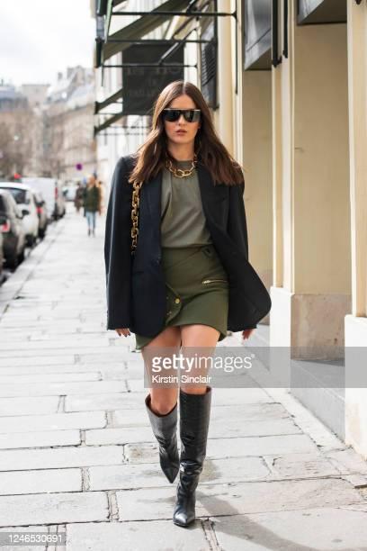 Digital influencer Paola Alberdi wears The Frankie Shop jacket and top, Luciana Balderrama skirt, Bottega Veneta bag, Paris Texas boots and Bulgari...