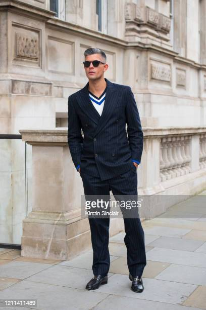 Digital Influencer Rayer VanRistell wears a Fendi suit Noska jumper Lacoste sunglasses and Gucci shoes during London Fashion Week February 2020 on...