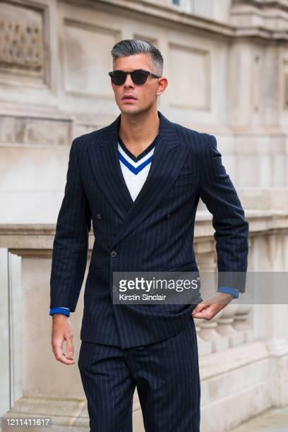 Digital Influencer Rayer VanRistell wears a Fendi suit Noska jumper Lacoste sunglasses during London Fashion Week February 2020 on February 18 2020...
