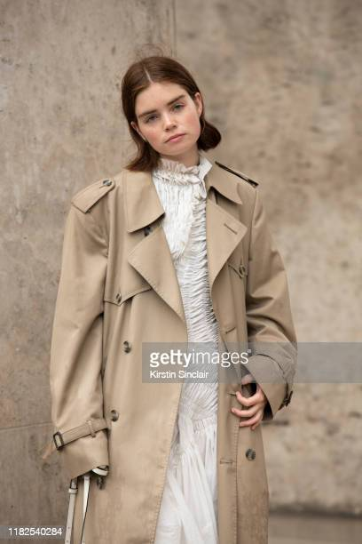 Digital influencer Reese Blutstein wears a Burberry trench coat and a Mugler dress on September 25, 2019 in Paris, France.