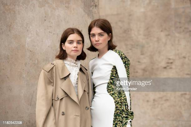 Digital influencer Reese Blutstein wears a Burberry trench coat and a Mugler dress with Digital influencer Molly Blutstein wearing a Mugler dress on...