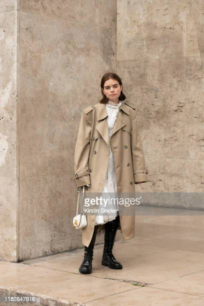 Digital influencer Reese Blutstein wears a Burberry trench coat, Mugler dress, J.W Anderson bag and Ann Demeulemeester boots on September 25, 2019 in...