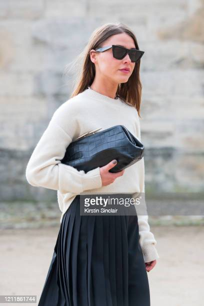 Digital influencer Sophia Roe wears a Dior jumper and skirt Celine sunglasses and a Little Liffner bag on February 25 2020 in Paris France
