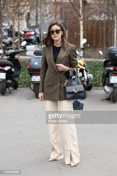 Digital Influencer Sylvia Haghjoo wears a Blaze Milano jacket and a Chloé bag during Paris Fashion Week AW19 on February 28 2019 in Paris France