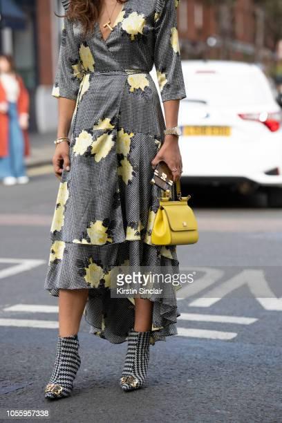 Digital Influencer Tamara Kalinic wears Balenciaga boots, Dolce and Gabbana bag, Ganni dress, Celine necklace, Louis Vuitton phone case during London...