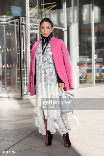 Digital Influencer Vicky Lee wears a Theory coat and jumper Baum und Pferogarten dress Julia Mays boots and an Alexandra De Curtis bag on day 2 of...