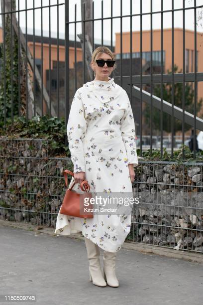 Digital Influencer Victoria Nasir wears an Acne dress Aesther Ekme bag Zara boots and Celine sunglasses on March 03 2019 in Paris France