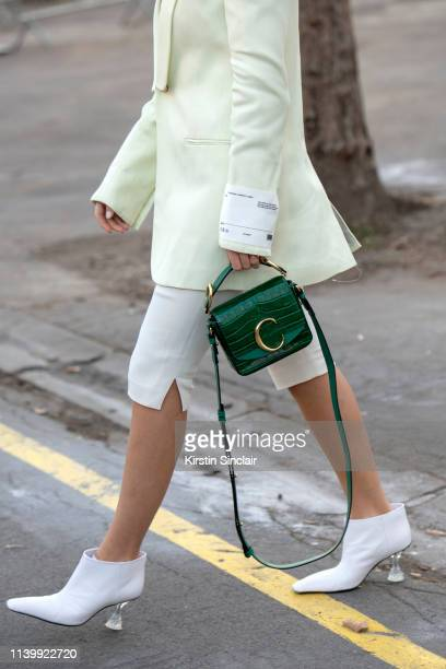 Digital Influencer Xenia Adonts wears a Chloe bag Celine boots and OffWhite jacket top and trousers on February 26 2019 in Paris France