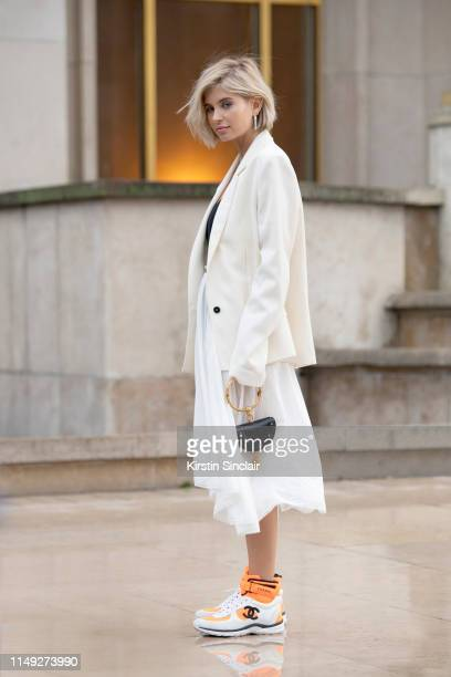 Digital Influencer Xenia Adonts wears a Chloe bag Chanel trainers Acne jacket and a Balenciaga skirt on March 02 2019 in Paris France