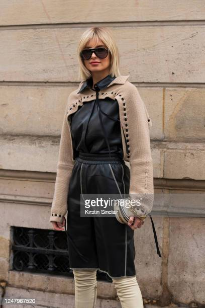Digital influencer Xenia Adonts wears a Chloe bag, Loewe knit, Nanushka leather playsuit and Tom Ford sunglasses on February 29, 2020 in Paris,...