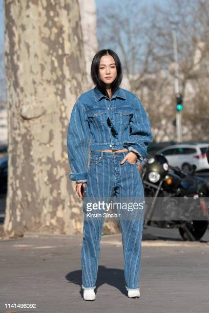 Digital Influencer Yoyo Cao wears a Mugler jacket and jeans with Balenciaga boots on February 27, 2019 in Paris, France.