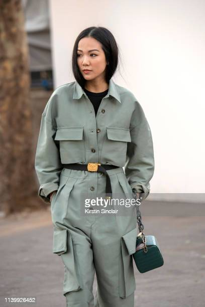 Digital Influencer Yoyo Cao wears The Volon bag Frankie Shop boiler suit and Chanel belt and a on February 26 2019 in Paris France