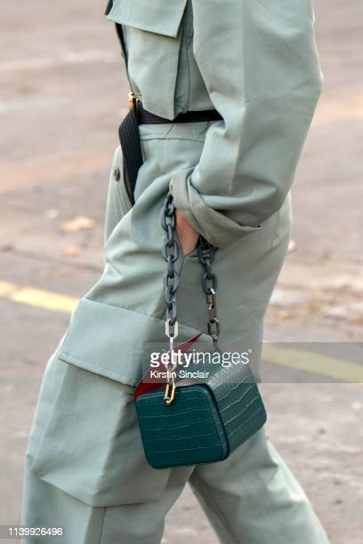 Digital Influencer Yoyo Cao wears The Volon bag Frankie Shop boiler suit and a Chanel belt on February 26 2019 in Paris France