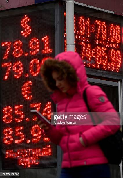 A digital information board shows exchange rates of the Russian rouble against the US Dollar and the Euro outside an exchange bureau in Moscow Russia...