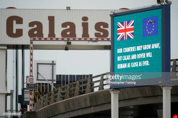 """Digital information screen at the Calais Ferry terminal declares that """"Our Countries May Grow Apart, But Calais and Dover Will Remain As Close As..."""
