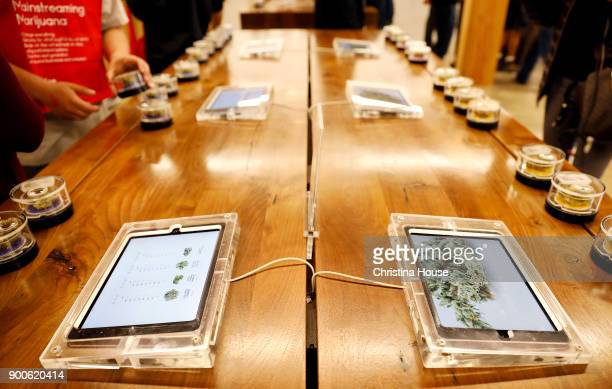 Digital menus and samples on a table as customers shop at MedMen on the first day of recreational marijuana sales January 2 2018 in West Hollywood...