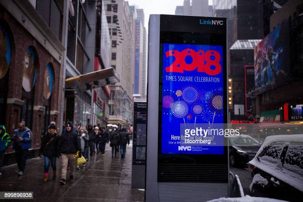 A digital monitor on a LinkNYC kiosk displays information ahead of New Year's Eve celebrations in the Times Square area of New York US on Saturday...