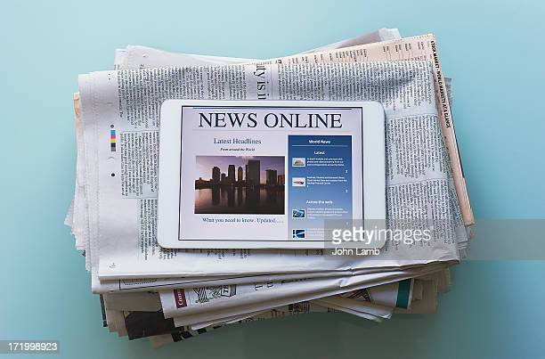 digital news delivery - western script stock pictures, royalty-free photos & images