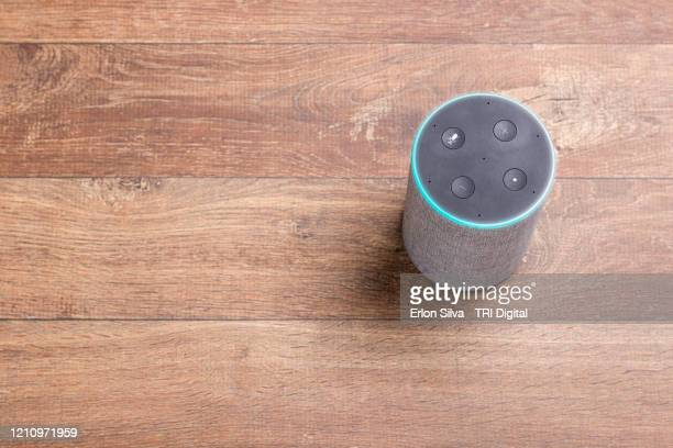 digital personal assistant on a wooden background with copy space for graphic composition - speech recognition stock pictures, royalty-free photos & images